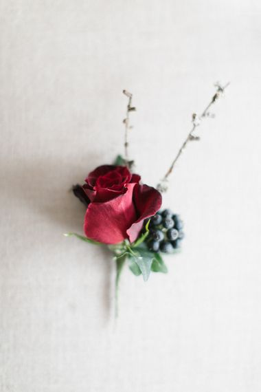 Red Buttonhole For Winter Wedding
