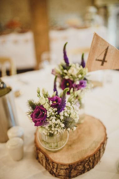 Rustic Wood Slice with Flower Stems in Jars | Intimate Anglers Rest Pub Wedding Reception | Antonija Nekic Photography
