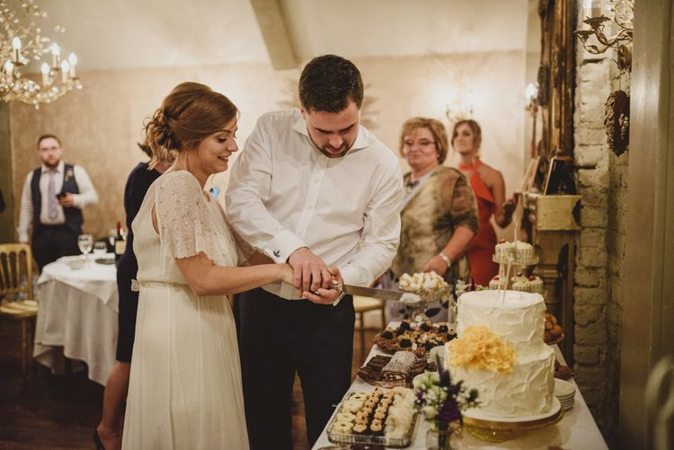 Cutting the Cake | Bride in Saja Wedding Dress | Groom in Louis Copeland Suit | Antonija Nekic Photography