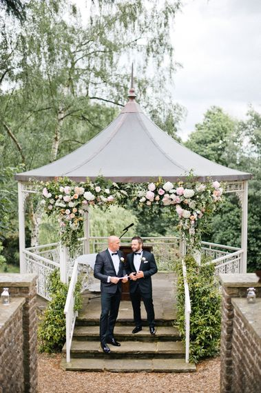 Arbour Flowers   Groom in Dolce & Gabbana Suit   Outdoor Blush Flower Filled Wedding at Pennyhill Park, Surrey Planned by Something Blue Weddings   Anushe Low Photography   Reel Weddings Film