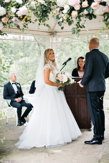 Outdoor Wedding Ceremony   Bride in Sassi Holdford   Groom in Dolce & Gabbana Suit   Pennyhill Park Wedding, Surrey, Planned by Something Blue Weddings   Anushe Low Photography   Reel Weddings Film
