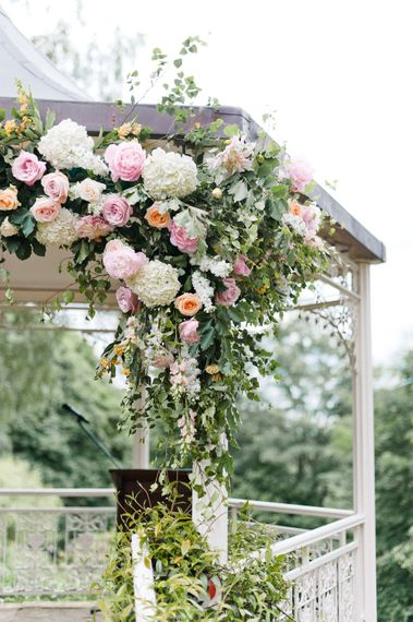 Pink, White & Green Flower Covered Arbour by Blue Sky Flowers   Pennyhill Park Wedding, Surrey, Planned by Something Blue Weddings   Anushe Low Photography   Reel Weddings Film