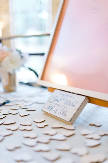 Woden Heart Alternative Guest Book Wedding Decor   Blush Flower Filled Wedding Reception at Pennyhill Park, Surrey Planned by Something Blue Weddings   Anushe Low Photography   Reel Weddings Film