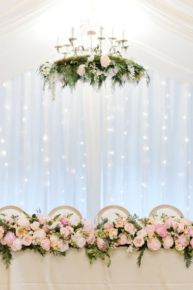 Fairy light Curtain, Hanging Floral Installation & Floral Table Runner Wedding Decor   Blush Flower Filled Wedding Reception at Pennyhill Park, Surrey Planned by Something Blue Weddings   Anushe Low Photography   Reel Weddings Film