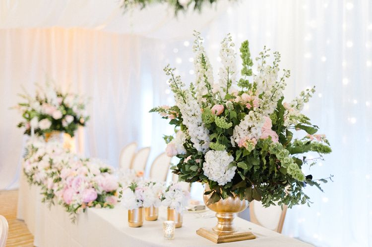 Pink & White Top Table Floral Arrangement   Blush Flower Filled Wedding Reception at Pennyhill Park, Surrey Planned by Something Blue Weddings   Anushe Low Photography   Reel Weddings Film