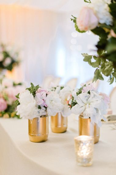 Pink & White Flower Stem Decor in Gold Jars   Blush Flower Filled Wedding Reception at Pennyhill Park, Surrey Planned by Something Blue Weddings   Anushe Low Photography   Reel Weddings Film