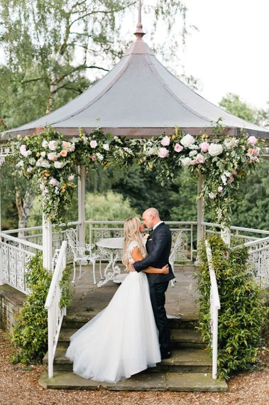 Bride in Sassi Holford Gown   Groom in Dolce & Gabbana Suit   Blush Flower Filled Wedding at Pennyhill Park, Surrey Planned by Something Blue Weddings   Anushe Low Photography   Reel Weddings Film