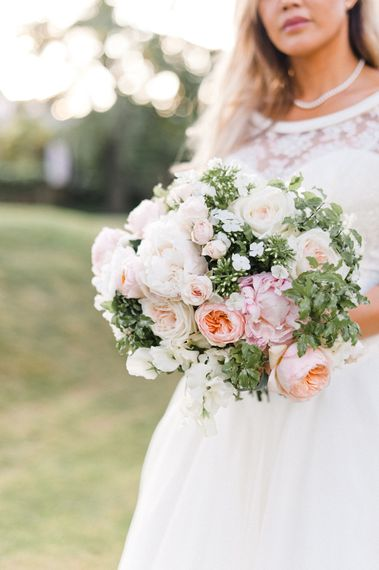 Romantic Pink & White Bouquet with Peonies & David Austin Roses   Bride in Sassi Holford Gown   Blush Flower Filled Wedding at Pennyhill Park, Surrey Planned by Something Blue Weddings   Anushe Low Photography   Reel Weddings Film