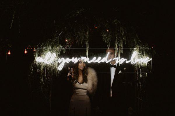 All You Need Is Love // Neon Sign For Wedding | Lauren Scotti Photography via Junebug Weddings