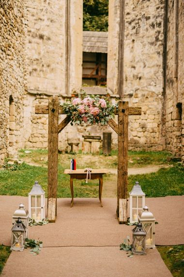 Wooden Altar with Floral Decor & Lanterns
