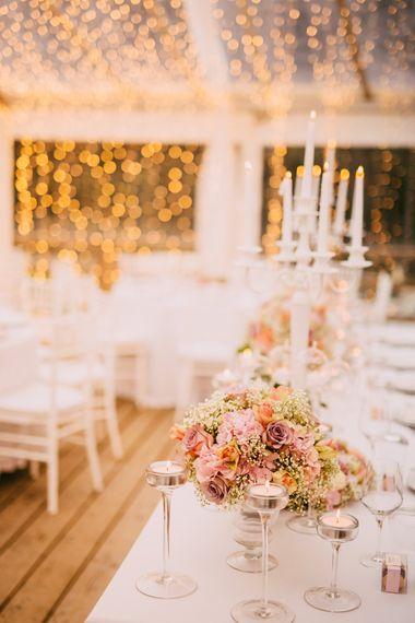 White Candelabra & Blush Pink Flower Wedding Reception with Fairy Light Backdrop