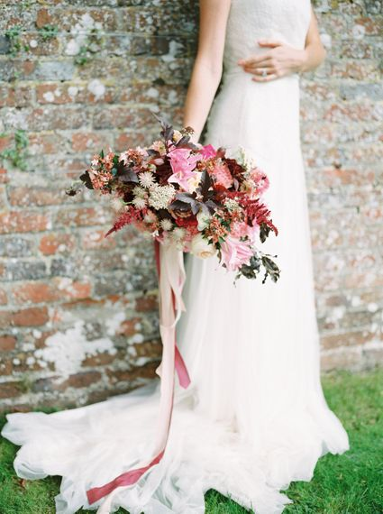 Red & Pink Bridal Bouquet by Martha & the Meadow | Naomi Neoh Bridal Gowns | Opulent Wedding Inspiration at Warmwell House in Dorset with Rich colour Palette Planned by Kelly Chandler | Imogen Xiana Photography | Gorgeous Films