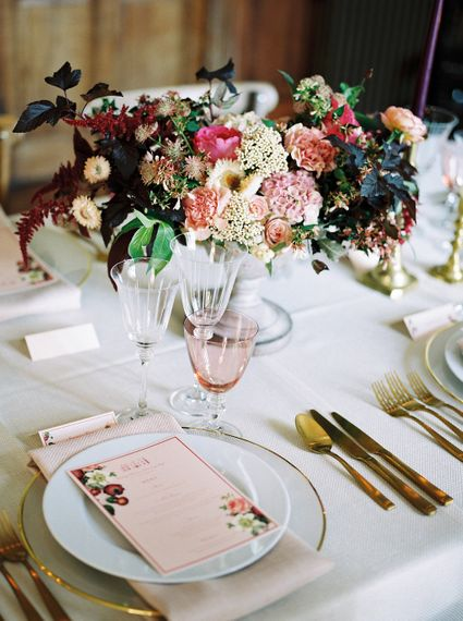 Rich Place Setting Decor with Taper Candles, Floral Centrepieces & Gold Cutlery | Opulent Wedding Inspiration at Warmwell House in Dorset with Rich colour Palette Planned by Kelly Chandler | Imogen Xiana Photography | Gorgeous Films