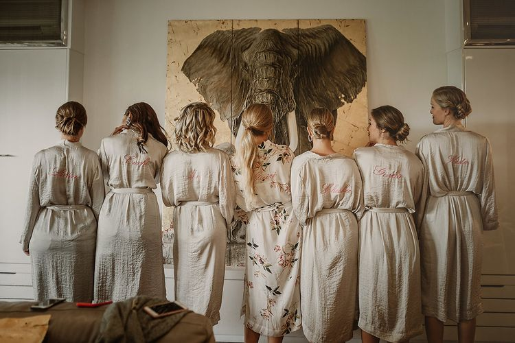 Bride & Bridesmaids In Floral Robes // Bohemian Festival Wedding In Large Glasshouse In Spain With Outdoor Ceremony And Pampas Grass Planning & Styling By La Puta Suegra Images By Pablo Laguia