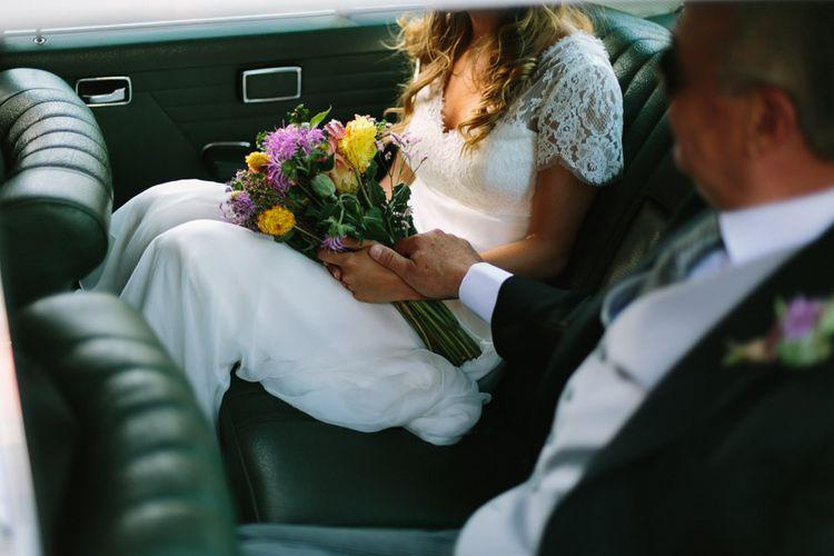 Bride in Xavier González Wedding Dress with Bright Bouquet