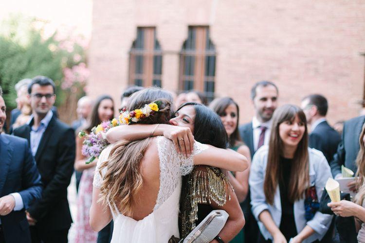 Bride in Xavier González Wedding Dress with Bright Flower Crown