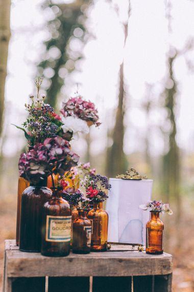 Glass Bottles & Flowers Wedding Decor
