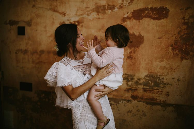Bride in Nevenka Lace Bridal Gown & Daughter | Spanish Wedding at Can Valldaura Planned by Collage eStudio | Images by Marcos Sanchez | Monika Frias Videography