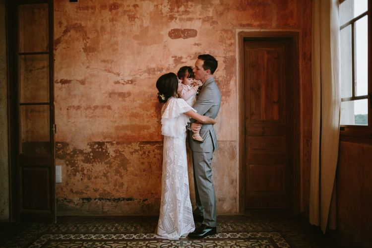 Bride in Nevenka Lace Bridal Gown | Groom in Grey Suit | Spanish Wedding at Can Valldaura Planned by Collage eStudio | Images by Marcos Sanchez | Monika Frias Videography