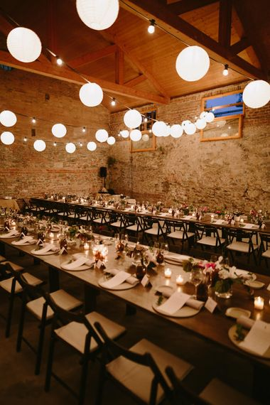 Festoon Lights & Trestle Tables | Spanish Wedding at Can Valldaura Planned by Collage eStudio | Images by Marcos Sanchez | Monika Frias Videography