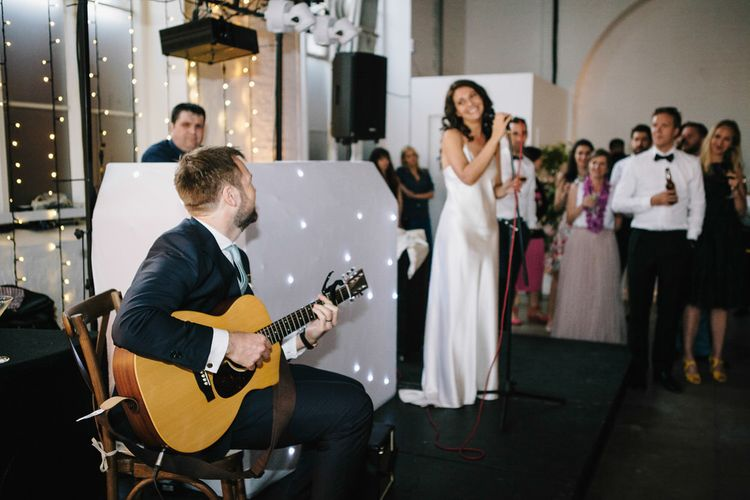 Bride & Groom Singing At Wedding // Trinity Buoy Wharf Wedding With Bride In Otaduy And Planning By Liz Linkleter Events Flowers By Grace And Thorn Images From My Beautiful Bride Photography