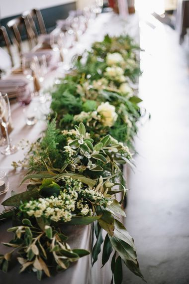 Floral Runner For Top Table // Trinity Buoy Wharf Wedding With Bride In Otaduy And Planning By Liz Linkleter Events Flowers By Grace And Thorn Images From My Beautiful Bride Photography