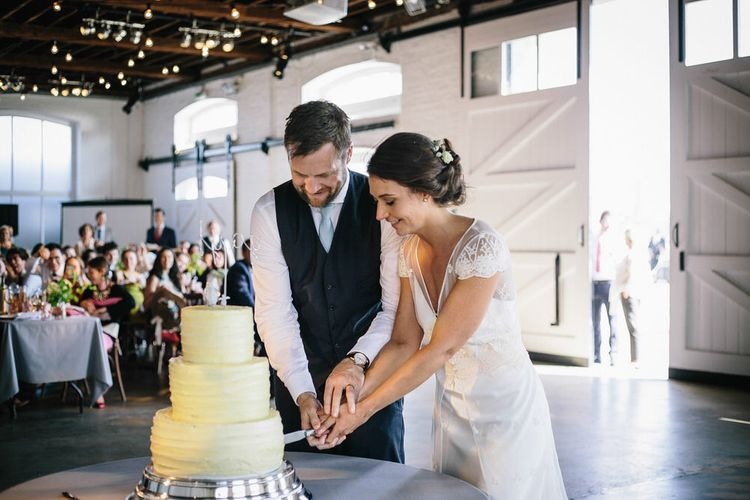 Cutting The Cake // Trinity Buoy Wharf Wedding With Bride In Otaduy And Planning By Liz Linkleter Events Flowers By Grace And Thorn Images From My Beautiful Bride Photography