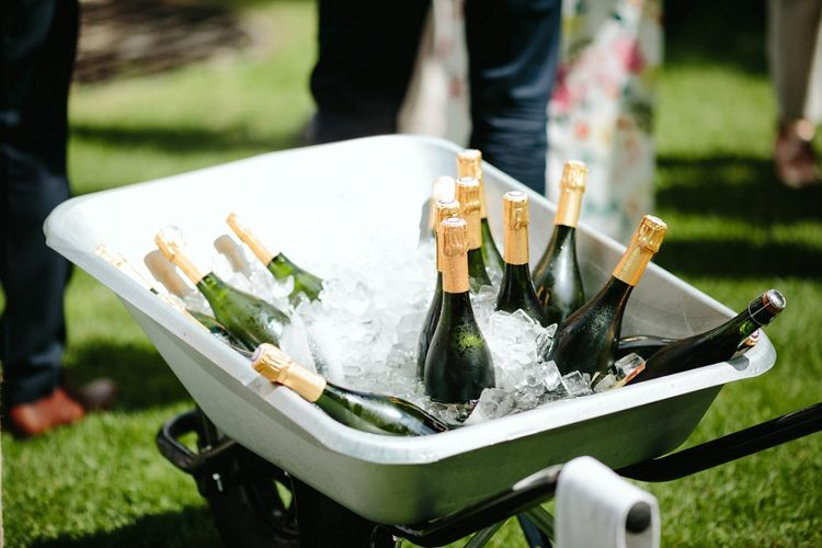 Champagne Bottles in Wheel Barrow | Outdoor Wedding at Chateau Rigaud in France | Real Simple Photography | Yellow Gazelle Film