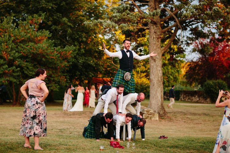 Human Pyramid | Groom in Tartan Kilt | Outdoor Wedding at Chateau Rigaud in France | Real Simple Photography | Yellow Gazelle Film