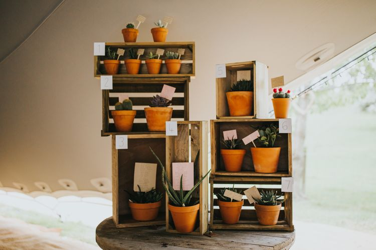 Terracotta Potted Plants in Wooden Crates Table Plan | 2 Day Festival Theme Wedding | Colin Ross Photography