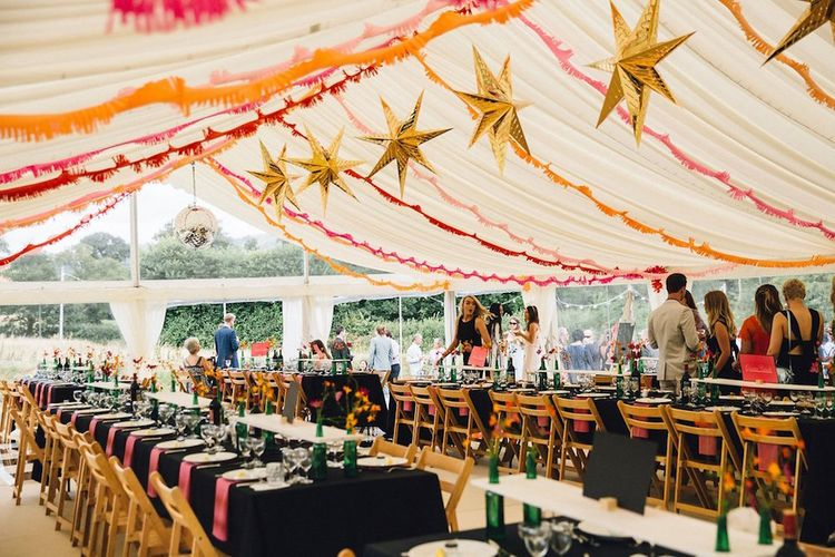 Marquee Wedding With Star Lanterns and With Black And Orange Decor