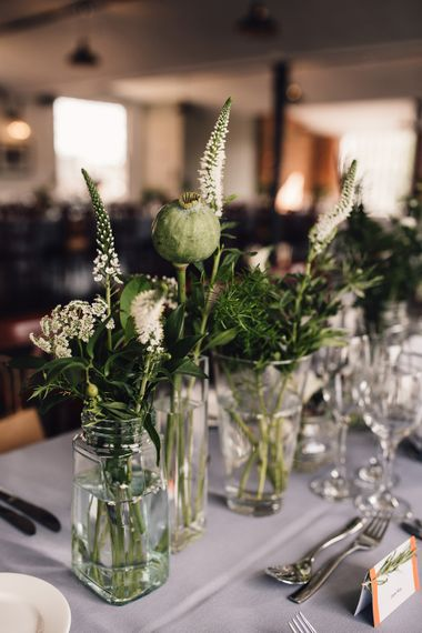 Green And White Flowers In Bud Vases For Wedding // Typography Table Plan For Wedding // The West Mill Derby Wedding With Images From Samuel Docker Photography Bride In Beaded Eliza Jane Howell Dress With Bridesmaids In Mismatched Pastel Dresses