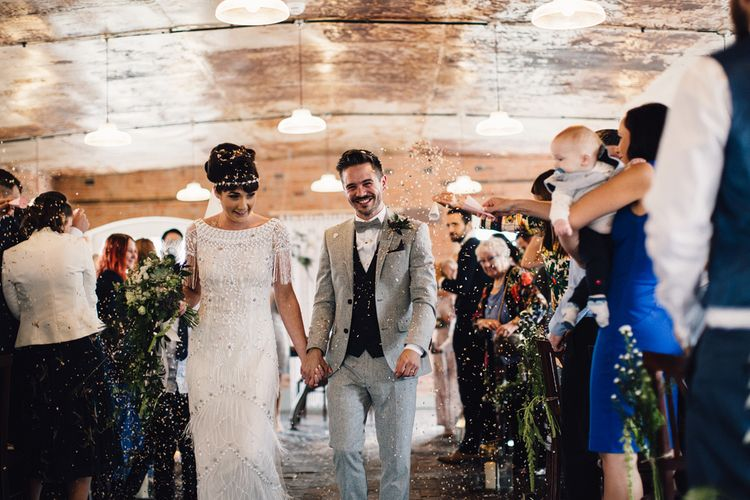 Walking Down The Aisle // The West Mill Derby Wedding With Images From Samuel Docker Photography Bride In Beaded Eliza Jane Howell Dress With Bridesmaids In Mismatched Pastel Dresses