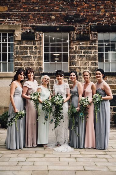 The West Mill Derby Wedding With Images From Samuel Docker Photography Bride In Beaded Eliza Jane Howell Dress With Bridesmaids In Mismatched Pastel Dresses