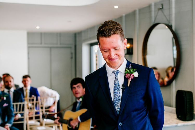 Groom at the Altar in Navy Ted Baker Suit   Colourful Coastal Wedding at The Gallivant in Camber Sands with DIY Decor   Epic Love Story Photography