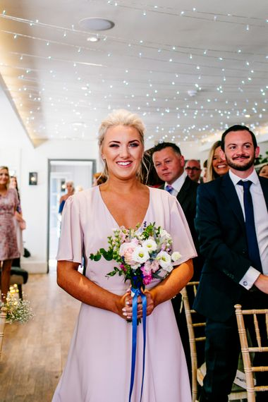 Bridesmaid in Blush ReWritten Wrap Dress   Colourful Coastal Wedding at The Gallivant in Camber Sands with DIY Decor   Epic Love Story Photography