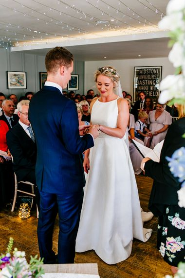 Wedding Ceremony   Bride in Jesus Peiro Wedding Dress   Groom in Navy Ted Baker Suit   Colourful Coastal Wedding at The Gallivant in Camber Sands with DIY Decor   Epic Love Story Photography