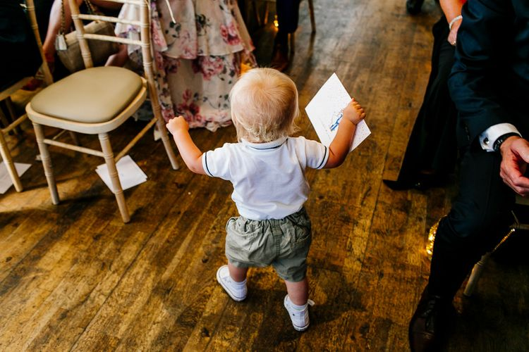 Wedding Ceremony   Page Boy in Shorts & Braces   Colourful Coastal Wedding at The Gallivant in Camber Sands with DIY Decor   Epic Love Story Photography