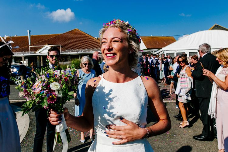Wedding Ceremony   Bride in Jesus Peiro Wedding Dress   Colourful Coastal Wedding at The Gallivant in Camber Sands with DIY Decor   Epic Love Story Photography