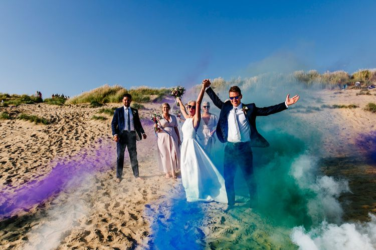 Smoke Bombs   Colourful Coastal Wedding at The Gallivant in Camber Sands with DIY Decor   Epic Love Story Photography