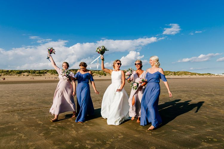 Bridesmaids in ReWritten Dresses   Bride in Jesus Peiro Gown   Colourful Coastal Wedding at The Gallivant in Camber Sands with DIY Decor   Epic Love Story Photography