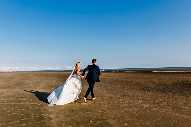 Beach Portrait   Bride in Jesus Peiro Gown   Groom in Navy Ted Baker Suit   Colourful Coastal Wedding at The Gallivant in Camber Sands with DIY Decor   Epic Love Story Photography