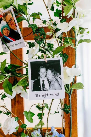 Polaroid Pictures on Trellis   Colourful Coastal Wedding at The Gallivant in Camber Sands with DIY Decor   Epic Love Story Photography