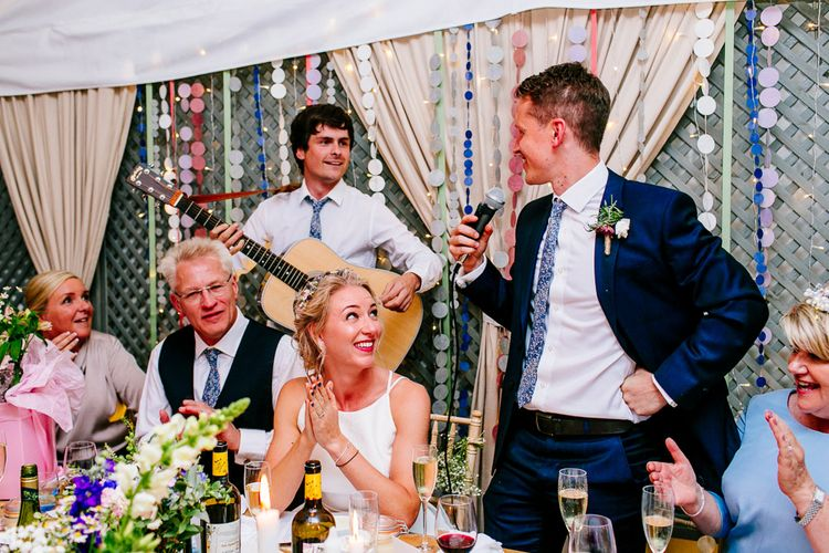 Bride in Jesus Peiro Gown   Groom in Navy Ted Baker Suit   Colourful Coastal Wedding at The Gallivant in Camber Sands with DIY Decor   Epic Love Story Photography