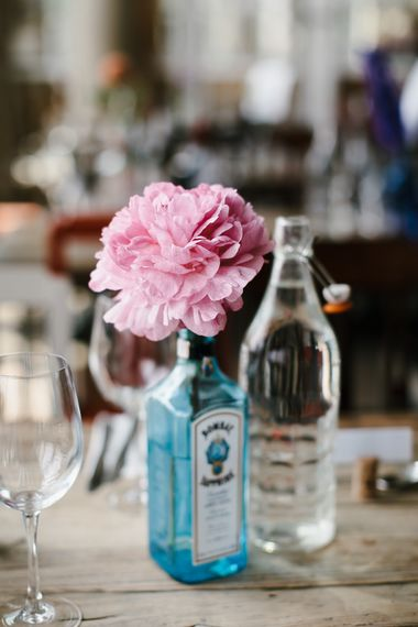 Coral Flower Stem in Gin Bottle | Bright Wedding at The Oyster Shed in London | Chris Barber Photography