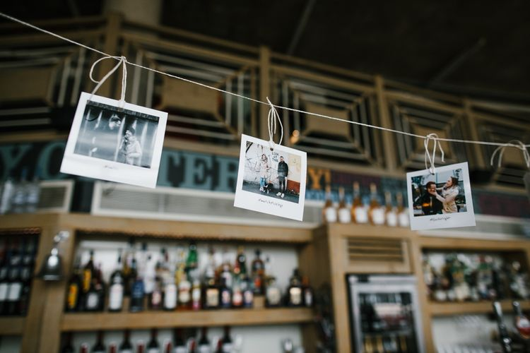 Polaroid Picture Bunting | Bright Wedding at The Oyster Shed in London | Chris Barber Photography