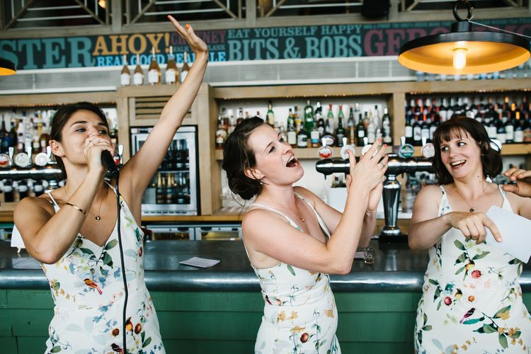 Bridesmaids in Floral Oasis Dresses | Bright Wedding at The Oyster Shed in London | Chris Barber Photography