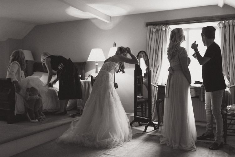 Bridal Preparations with Bride in Monique Lhuillier Candy Wedding Dress