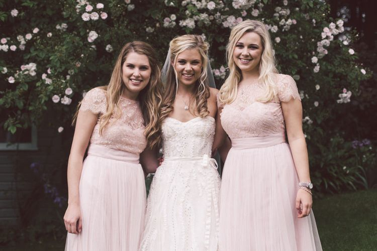 Bride in Monique Lhuillier Candy Wedding Dress & Bridesmaids in Pink BHLDN Dresses