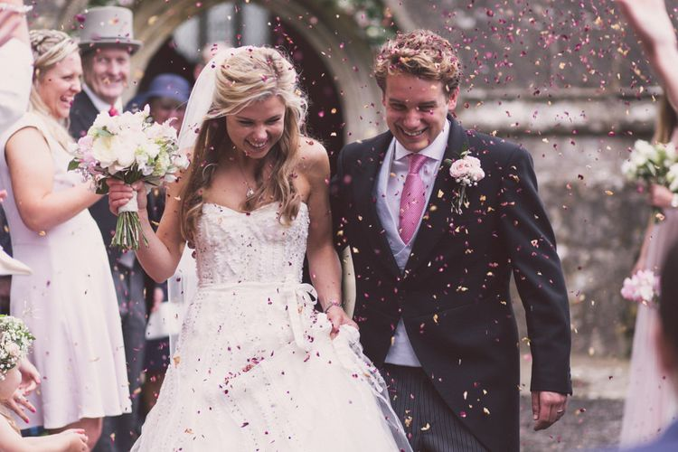 Church Exit Confetti Moment with Bride in Monique Lhuillier Candy Wedding Dress